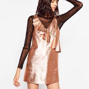 Metallic rose gold shift dress with ruffle